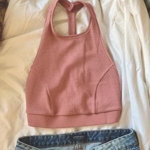 Open-backed, soft textured pink crop tank